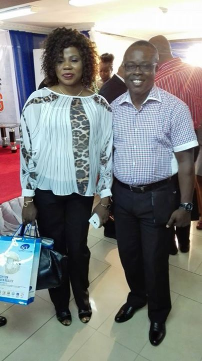Standing with Mrs. Adebisi Orekoya (The woman whose three kids were kidnapped and recovered recently in Lagos) at a seminar on Averting The Rising Spate of Child Kidnapping in Nigeria organised by Background Check Int.(BCI)